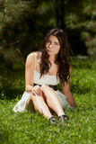 Young Girl Chilling In Green Park Outdoors Royalty Free Stock Images