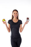 Young girl with chocolate and apple Royalty Free Stock Photo