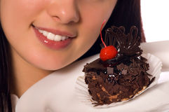 Young girl with chocolate cake. (isolated on white royalty free stock photos