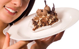 Young girl with chocolate cake. (focus on face stock photo