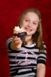 Young girl with a chocolate cupcake Stock Photography