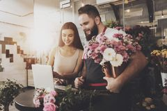 Young girl chooses bouquet option on laptop royalty free stock photography