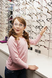 Young girl choosing glasses Royalty Free Stock Photography