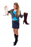 Young girl choosing new boot Royalty Free Stock Images