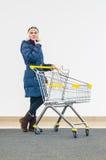 Young girl choosing to shopping royalty free stock photos
