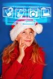 Young girl choosing virtual gift for christmas Stock Images