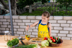 Young Girl Chopping Fresh Vegetables for Canning Stock Image