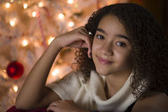 Young girl at Christmas stock images