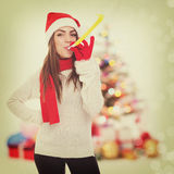 Young girl in Christmas atmosphere Stock Images