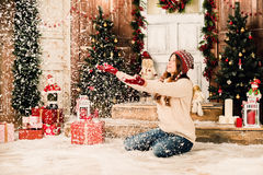 Young girl in Christmas background Stock Photos