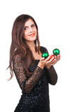 Young girl with christmas balls in hands Royalty Free Stock Photos