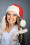 The young girl in the Christmas cap and mittens Royalty Free Stock Image
