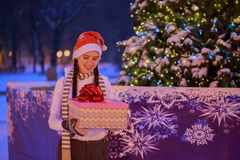 Young girl on Christmas Eve under the Christmas tree  Stock Photo