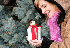 Young girl with christmas gift Stock Images