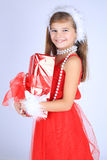 Young girl with christmas gift Royalty Free Stock Images