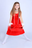 Young girl with christmas gift Royalty Free Stock Photo