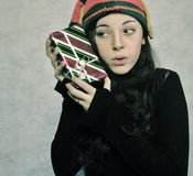 A young girl with a Christmas gift. Stock Image