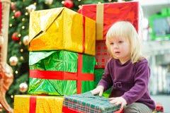 Young girl among christmas gifts Royalty Free Stock Image