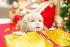 Young girl among christmas gifts Royalty Free Stock Photos