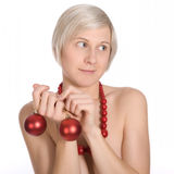 Young girl with christmas ornaments in studio Stock Photos
