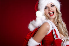 Young girl in christmas outfit. Woman with ribbon box gift. Sant Royalty Free Stock Photography