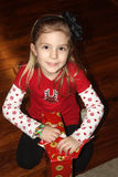 Young Girl with Christmas Present Royalty Free Stock Images