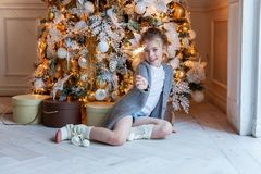 Young girl with Christmas sparkler Royalty Free Stock Images