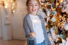 Young girl with Christmas sparkler Stock Photos