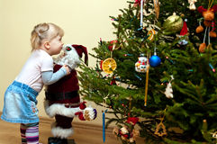 Young girl and Christmas tree Royalty Free Stock Photo