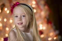 Young girl By Christmas tree Royalty Free Stock Image