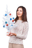 Young girl with christmas tree in hands Royalty Free Stock Image