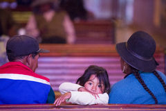 Young girl in church with her family, Tupiza - Bolivia Royalty Free Stock Images