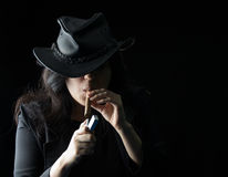 Young girl with cigar and lighter Stock Images