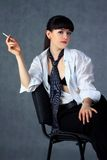 The young girl with a cigarette stock images