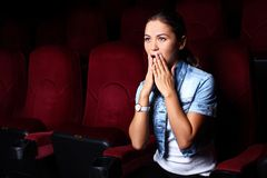 Young girl in cinema Royalty Free Stock Photos