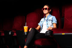 Young girl in cinema Stock Photos