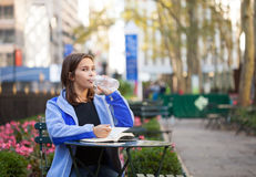 Young girl in city park Stock Photos