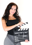 Young girl with clapper board Royalty Free Stock Photography