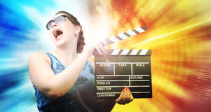 Young girl with clapper board on abstract color Stock Photo