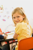Young Girl in Classroom Royalty Free Stock Images