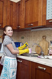 Young Girl Cleaning Dishes Royalty Free Stock Image