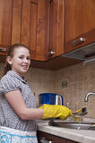 Young Girl Cleaning Dishes stock photography