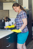 Young girl cleaning stove Royalty Free Stock Photo