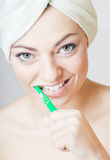 Young girl cleaning teeth Royalty Free Stock Photos