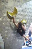 Young girl climber climbs indoors royalty free stock image