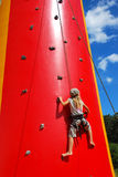 Young girl climbing Royalty Free Stock Photos