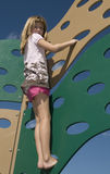 Young girl climbing Royalty Free Stock Photos