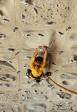 Young girl climbing an artificial wall Royalty Free Stock Images