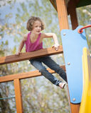 Young girl climbing on childrens playground Royalty Free Stock Images