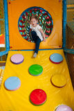 Young girl climbing down ramp in soft play centre Stock Photography